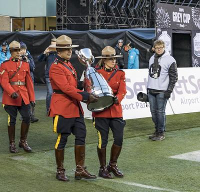 Members of the RCMP carried the Grey Cup onto the field.