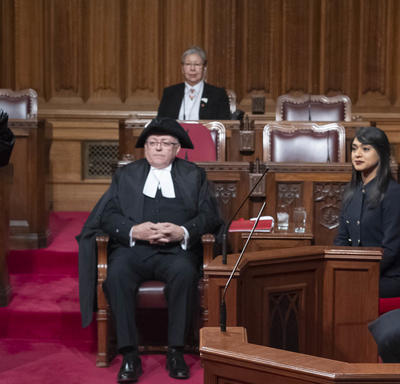 The Governor General is sitting in the Senate Chamber and the Usher of the Black Rod is acknowledging her presence.