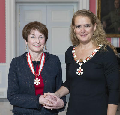 Governor General, Julie Payette, stands next to Elizabeth Eisenhauer. Both wear their Order of Canada insignias.