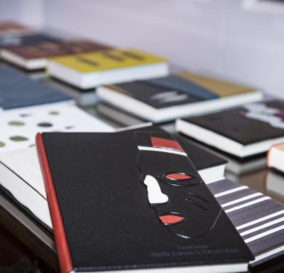 A table lined with beautiful leather bound book.