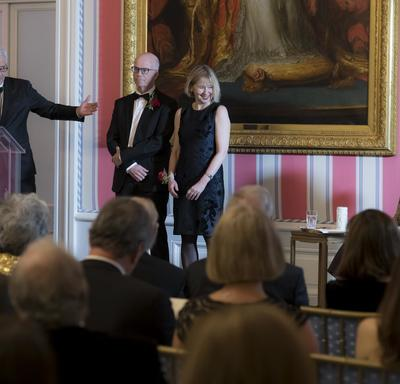Lori Saint-Martin and Paul Gagné stand on stage.  The Governor General, Julie Payette, sits to their right.  M. Charles Tisseyre stand at the podium to their right.