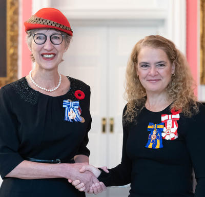 The Governor General stands next to recipient Beverley Tosh who is wearing the Meritorious Service Medal (Civil Division) she has just received.