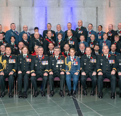 A group photo of the 69 newly invested members of the Order of Military Merit. Vice Chief of the Defence Staff,   Lieutenant-General Paul Wynnyk, and  Her Excellency the Right Honourable Julie Payette are seated in the center of the front row.