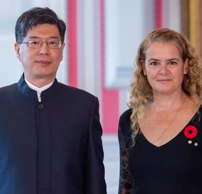 His Excellency Peiwu Cong, Ambassador of the People's Republic of China, stands beside the Governor General.