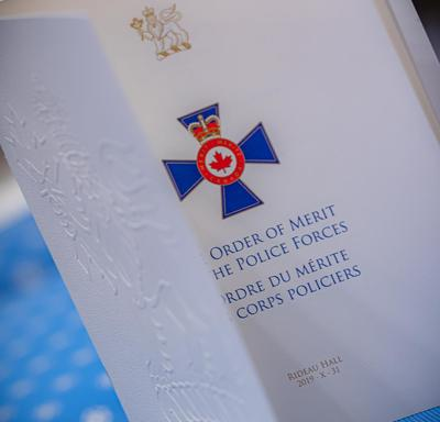 A photo of the Order of Merit of the Police Forces Program.