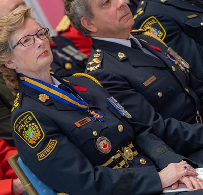 Recipients of the Order of Merit of the Police Forces sit in the front row during the investiture ceremony.