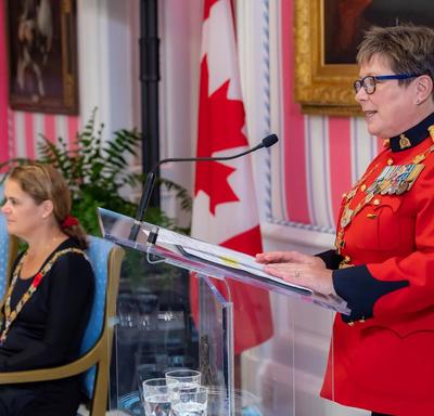 Brenda Lucki, Commissioner of the RCMP, delivers remarks at a podium during an Order of Merit of the Police Forces investiture ceremony.