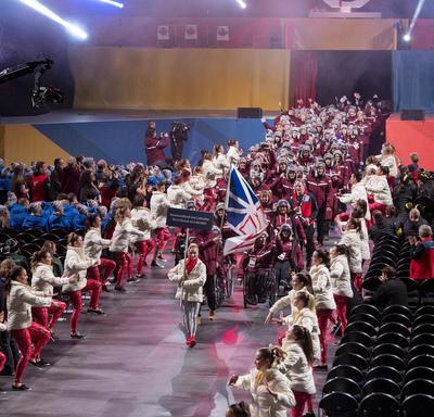 The team from Newfoundland and Labrador walk into the arena.
