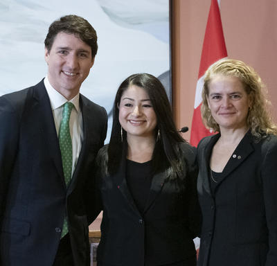 Maryam Monsef poses for a photo alongside Prime Minster Justin Trudeau, on her right, and Governor General Julie Payette, on her left.
