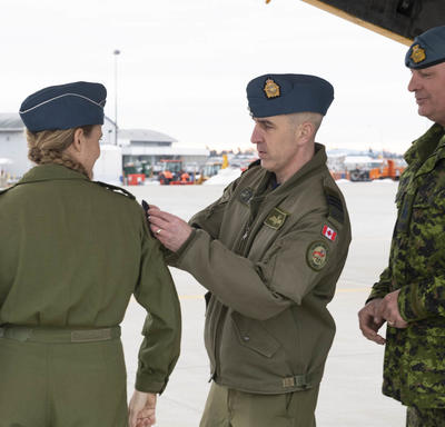 The Governor General receives a military patch by a CAF member.
