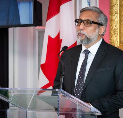 Ali Kazimi speaking from the podium.