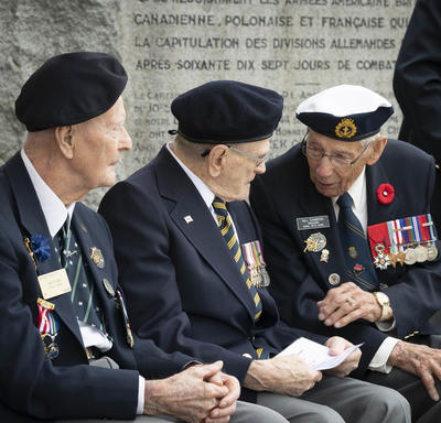 Veterans speaking to each other.