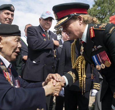 The Governor General shakes hands with a veteran.