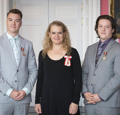 The Governor General stands between Brothers Jeremy (left) and Devon Liscum (right).