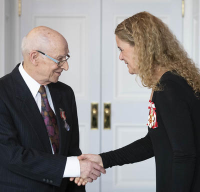 The Governor General shakes hands with René Rheault.