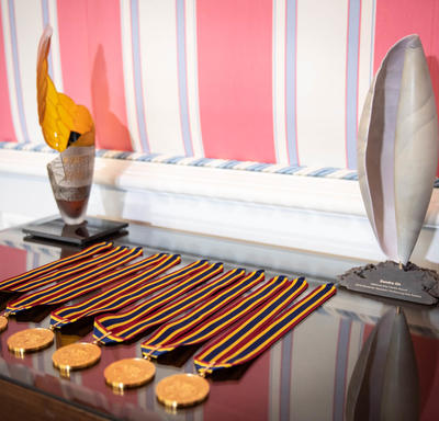 The medals are laid out on a table.