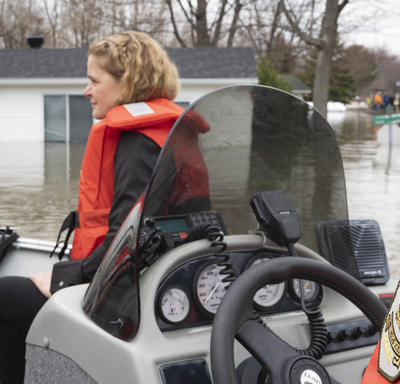 The Governor General is touring the affected areas in a motor boat.