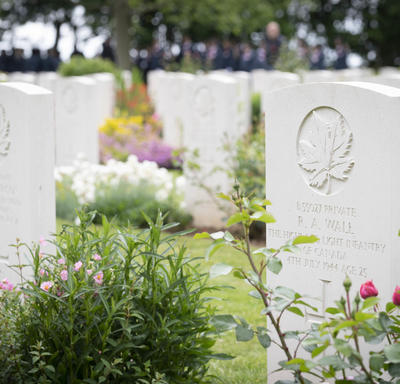 White tombstone in Bény-sur-Mer Canadian War Cemetery.