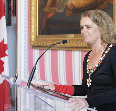 The Governor General delivers remarks at a podium