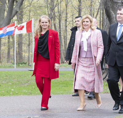 The Governor General, the President of the Republic of Croatia and Mr. Jakov Kitarović walk with each other on the grounds of Rideau Hall.