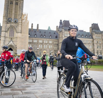 The Governor General departs Parliament Hill by bike