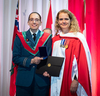 The Governor General gave the Governor General's Academic Medal to winning student.