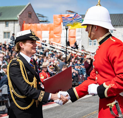 The Governor General handed commissioning scrolls to a member of RMC.