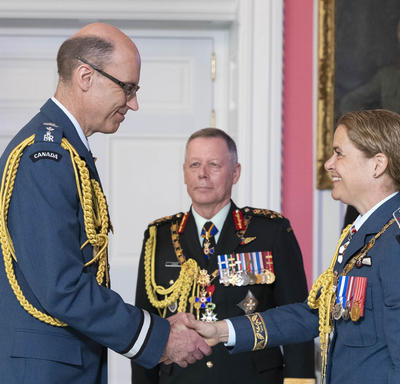 The Governor General shakes hands with Brigadier-General Andrew Michael Downes, O.M.M., C.D.