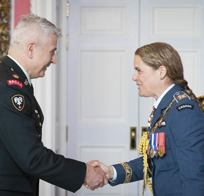 The Governor General shakes hands with Major Slade Gestur John Lerch, M.M.M., C.D.