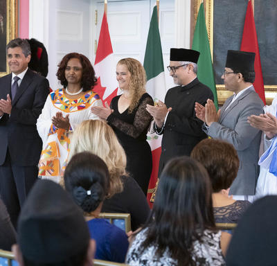 The five new heads of mission are posing for a group picture with the Governor General.