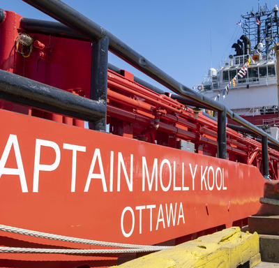 Side view of the red and white Canadian Coast Guard Ship Captain Molly Kool.