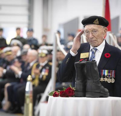 Veteran salutes a pair of boots.