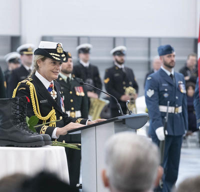 The Governor General delivers remarks at a podium.