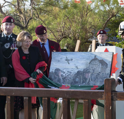 The Governor General unveils a painting that depicts the Battle of Normandy.