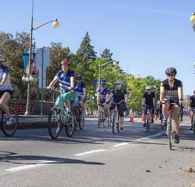 The Governor General cycles along Sussex Drive alongside Navy Bike Ride participants