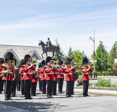 The Band of the Ceremonial Guard perform in front of the Queen Elizabeth II Equestrian Monument.