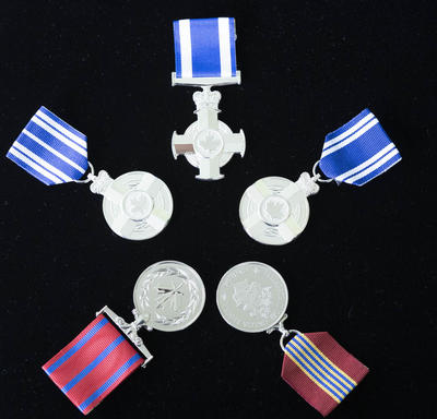 A picture of the various medals presented to recipients at the military-themed honours ceremony