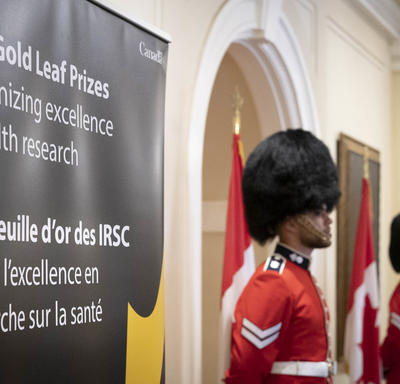 Two ceremonial foot guards stand at attention on either side of a doorway at Rideau Hall.