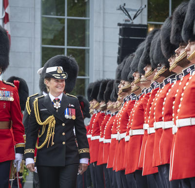 The Governor General inspects the Ceremonial Guard, accompanied by the Commander.