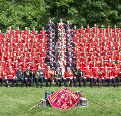 Members of the Ceremonial Guard gather to take a group photo, creating a sea of red.
