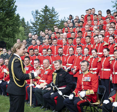 The Governor General speaks intimately to members of the Ceremonial Guard, moments after the group photo.