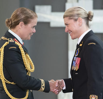Chief Petty Officer 2nd Class Tanya Lea Leavitt shakes hands with the Governor General.