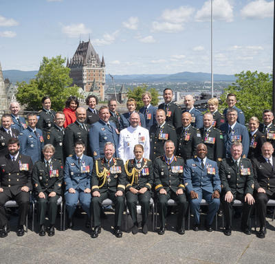 Newly invested members of the Order of Military Merit take a photo as a group.