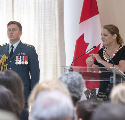 The Governor General delivers a speech at a podium.