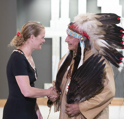 Dominique Rankin shakes hands with the Governor General.