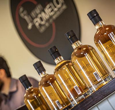 A photo of Verger Poméloi cider bottles lined up, sealed and ready for distribution.