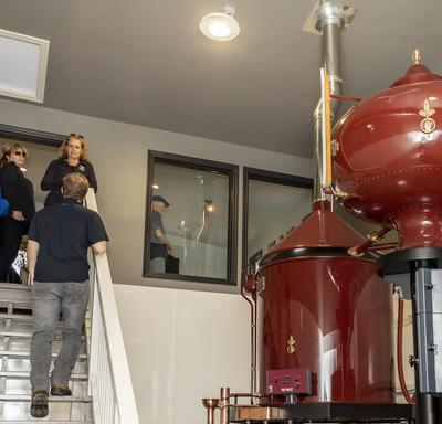 The Governor General is shown the Alembic room inside the Verger Poméloi where the distilling takes place.