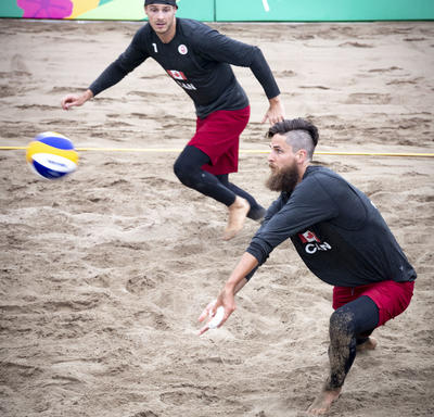 Canada men's beach volleyball players Aaron Nusbaum and Mike Plantinga played against Mexico.