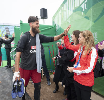 The Governor General gave Canada men's beach volleyball players Aaron Nusbaum and Mike Plantinga high fives after the game.