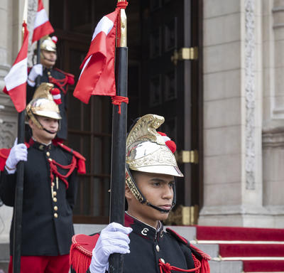 Guards welcomed the Governor General to the Peruvian presidential palace.